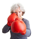 Senior woman with boxing gloves Stock Photography