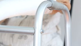 Senior woman broken wrist using walker stock video