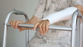 Senior woman broken wrist using walker stock video footage
