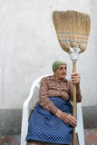 Senior woman broom Stock Image