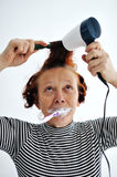Senior woman brushing teeth Royalty Free Stock Image