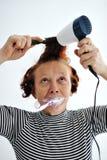 Senior woman brushing teeth royalty free stock image