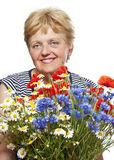 Senior woman with bunch of flowers Royalty Free Stock Photo