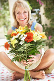 Senior Woman With Bunch Of Flowers Royalty Free Stock Photos