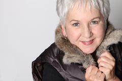 Senior Woman Bundled Up for Winter. Close Up Attractive Senior Woman Dressed for Winter with Fur Collar royalty free stock photography