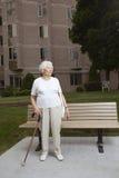 Senior woman at a bus stop royalty free stock photos