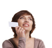 Senior woman with business card. Happy senior woman with business card looking up on white background Stock Photo