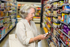 Senior woman buying food stock image