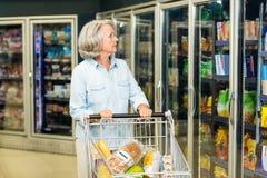 Senior woman buying food Stock Photo