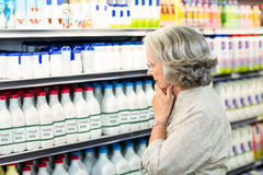 Senior woman buying milk Royalty Free Stock Images