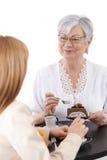Senior woman with cake smiling Stock Photos