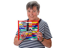Senior woman calculating with abacus Stock Photos