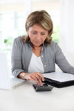 Senior woman calculating budget Stock Images