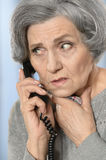 Senior woman calling her doctor Royalty Free Stock Image