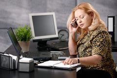 Senior woman calling in office Royalty Free Stock Photo