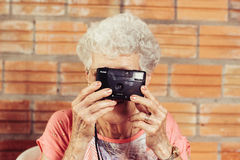 Senior woman with camera