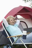 Senior Woman Beside Camping Tent Stock Image