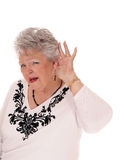 Senior woman can not hear right. stock image