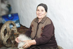 Senior woman carding woollen yarn Stock Photography
