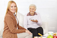 Senior woman and caregiver eating royalty free stock images