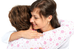 A senior woman and caregiver hugging Stock Image