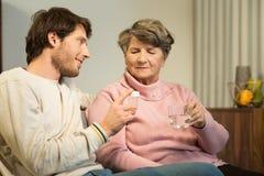 Senior woman and caring grandson Stock Photos