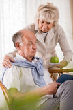 Senior woman caring about husband Royalty Free Stock Image
