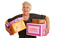 Senior woman carrying many presents Royalty Free Stock Photo