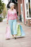 Senior Woman Carrying Shopping Bags Stock Image