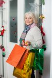 Senior Woman Carrying Shopping Bags At Home Royalty Free Stock Photography
