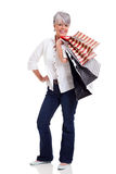 Senior woman carrying shopping Royalty Free Stock Photos