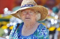 Senior woman celebrating Australia Day in traditional flags hat outdoors