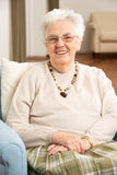 Senior Woman In Chair At Home Stock Images