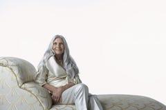 Senior Woman On Chaise Lounge Stock Photos