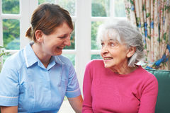 Senior Woman Chatting With Carer. Senior Woman Talking With Carer royalty free stock photo