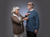 Senior woman checking heart beat. Old couple. Senior women taking care, checking heart beat of husband with stethoscope royalty free stock images