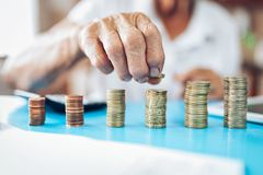 Senior woman checking her finances and investments stock image