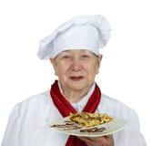 Senior woman in chef hat Stock Photos