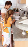 Senior woman and child baking Stock Images