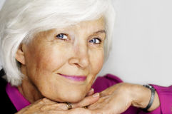 Senior woman chin on hands Stock Photography