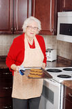 Senior woman christmas baking Stock Image