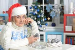 Senior woman with Christmas decorations Stock Photo