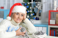 Senior woman with Christmas decorations Stock Images