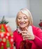Senior Woman With Christmas Gift Royalty Free Stock Photos