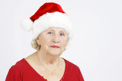 Senior woman with Christmas hat Royalty Free Stock Photography