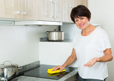Senior woman cleaning Stock Image