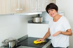 Senior woman cleaning Stock Photos