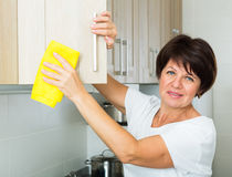 Senior woman cleaning Stock Photo