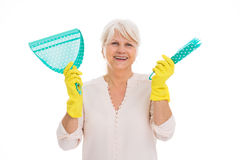 Senior woman with cleaning supplies and rubber gloves Royalty Free Stock Image