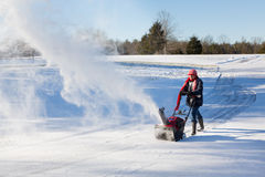 Senior woman clearing drive with snowblower Stock Photography